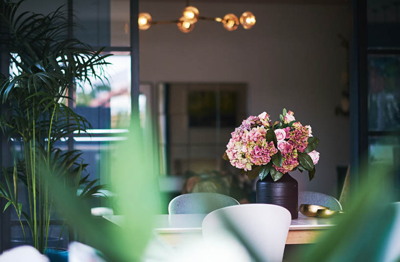 pink hydrangeas in a vase on a table